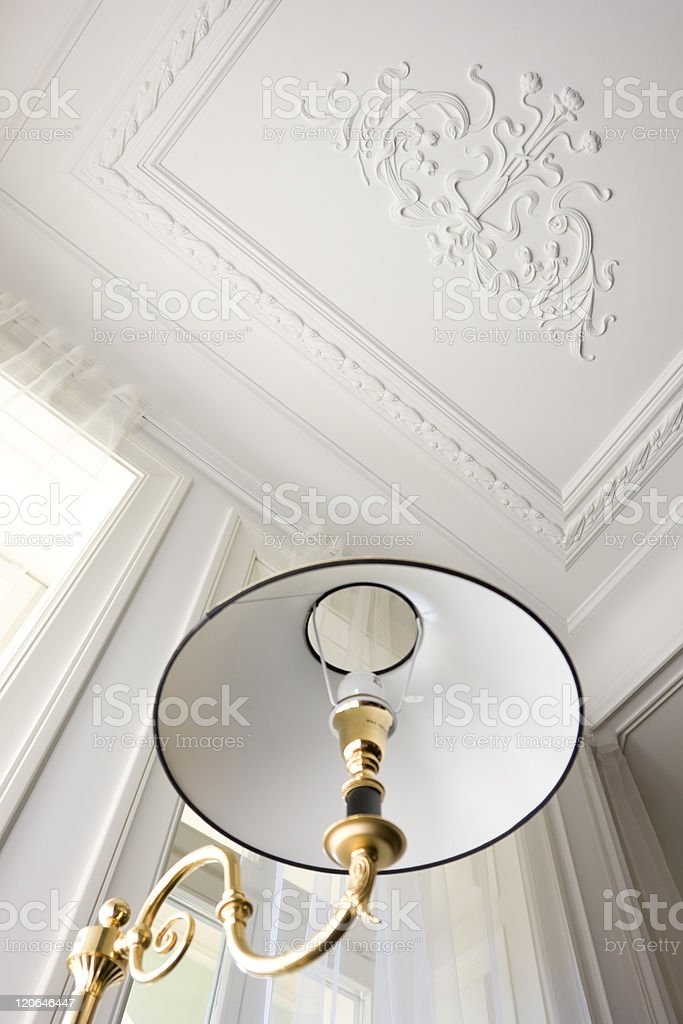 part of floor lamp from below and ceiling stock photo