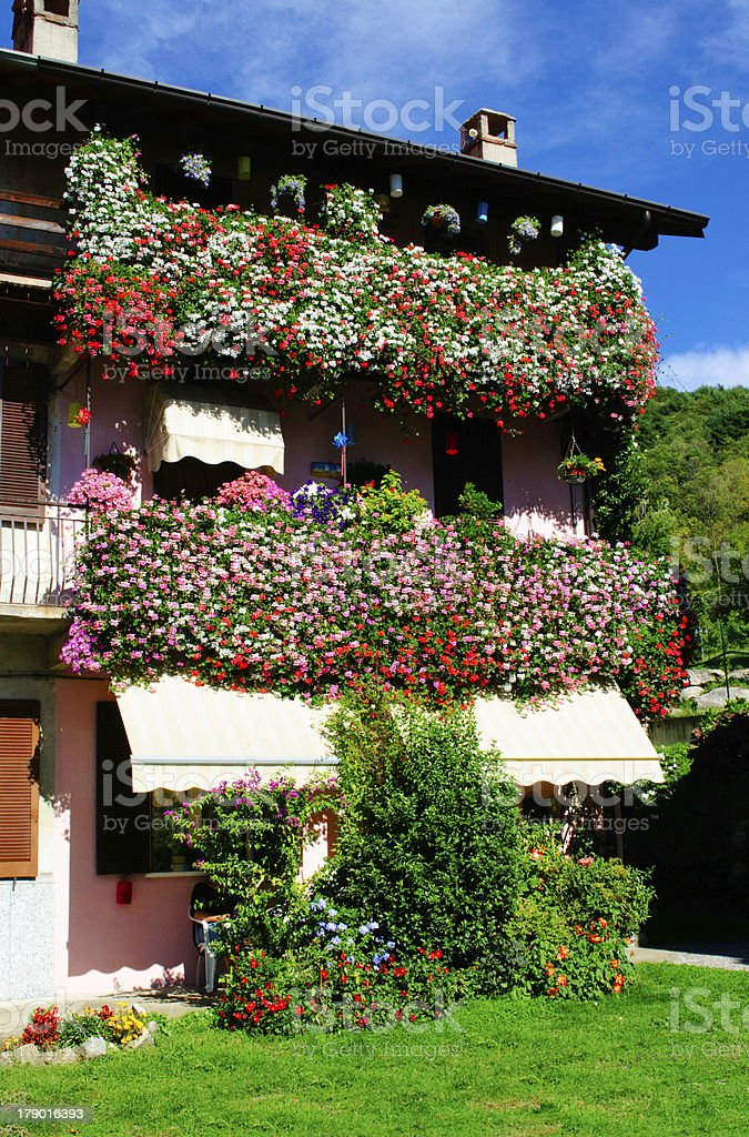 Part of house with flowers royalty-free stock photo