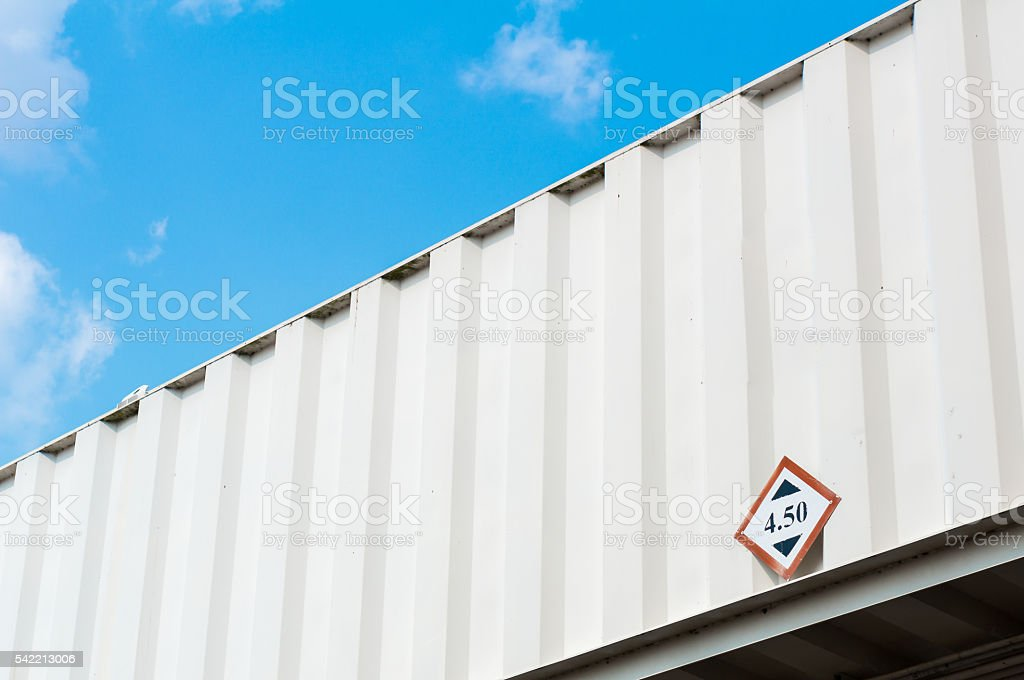 Part of jetway with height restricition sign stock photo