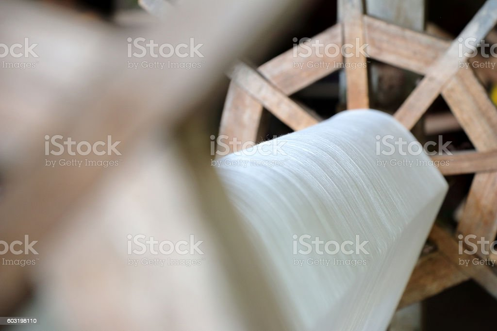 part of loom white thread homemade, selective focus stock photo