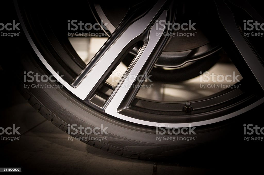 Part of new tire on alu rim stock photo