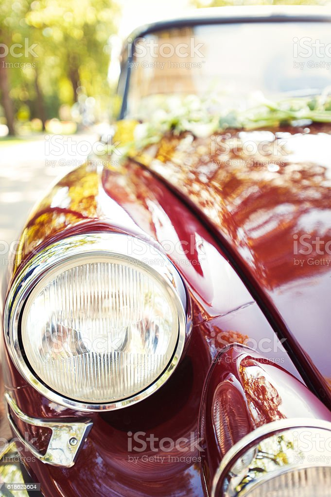 Part of old antique red retro car. Closeup front view. stock photo