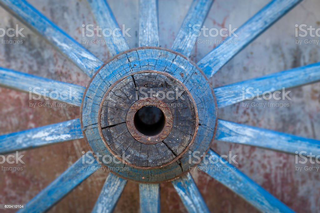 Part of old ironed, blue wagon or carriage wheel stock photo
