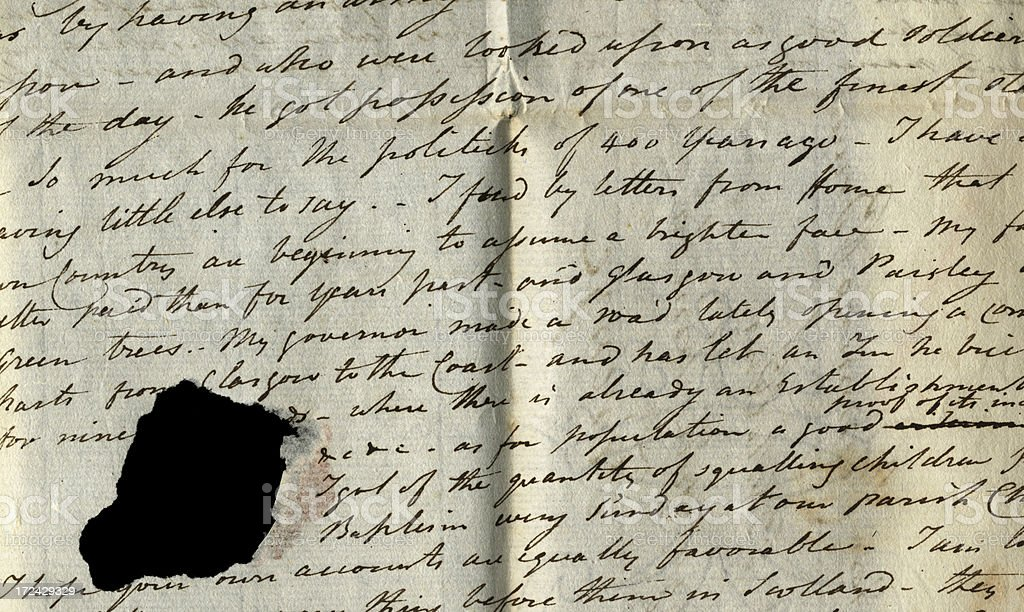 Part of old letter with hole stock photo