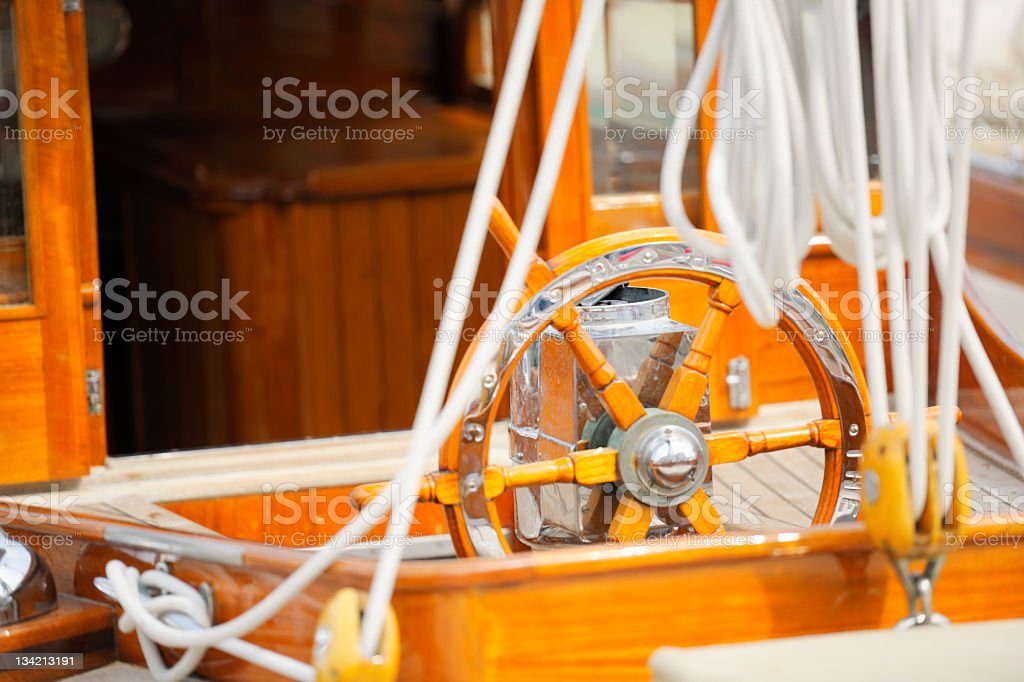 Part of Old Wood Sailing Boat with Wheel and Ropes stock photo