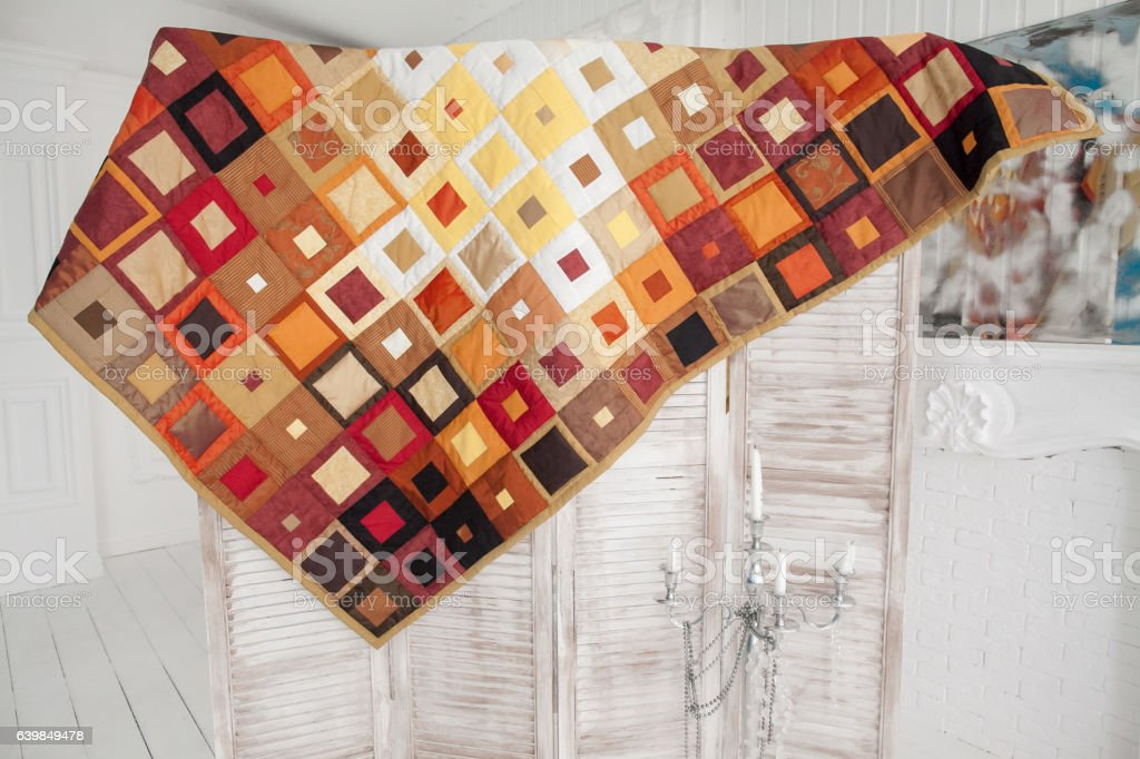 Part of patchwork quilt as background. Handmade stock photo