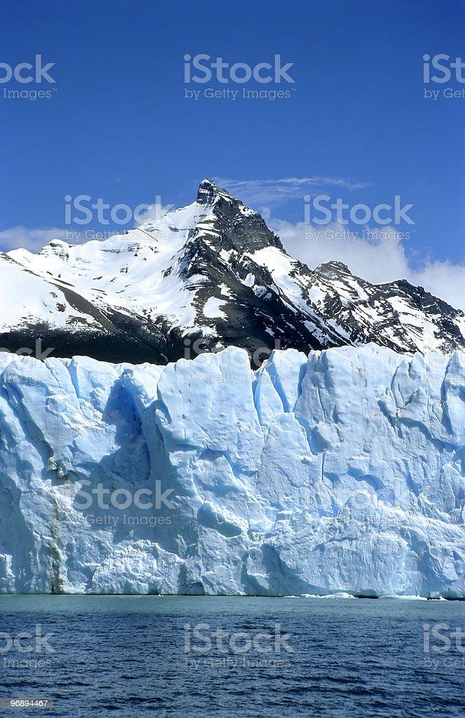 Part of Perito Moreno glaciar and a mountain peak royalty-free stock photo