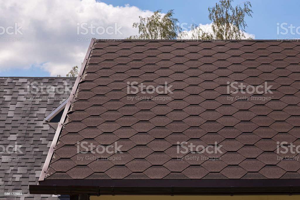 Part of red bitumen tiles roof stock photo