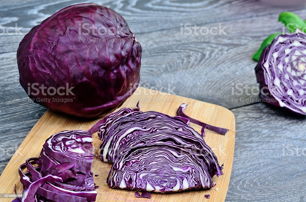 part of red cabbage on table stock photo