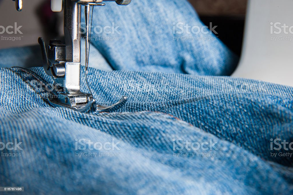 Part of sewing machine and jeans cloth stock photo