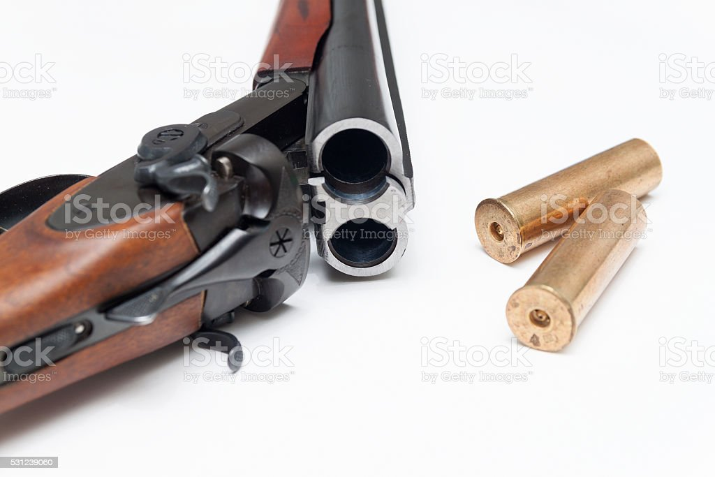 Part of shotgun and ammunition on white stock photo