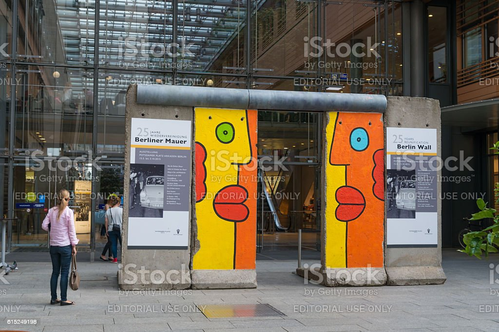 Part of the Berlin wall at entrance of shopping center stock photo