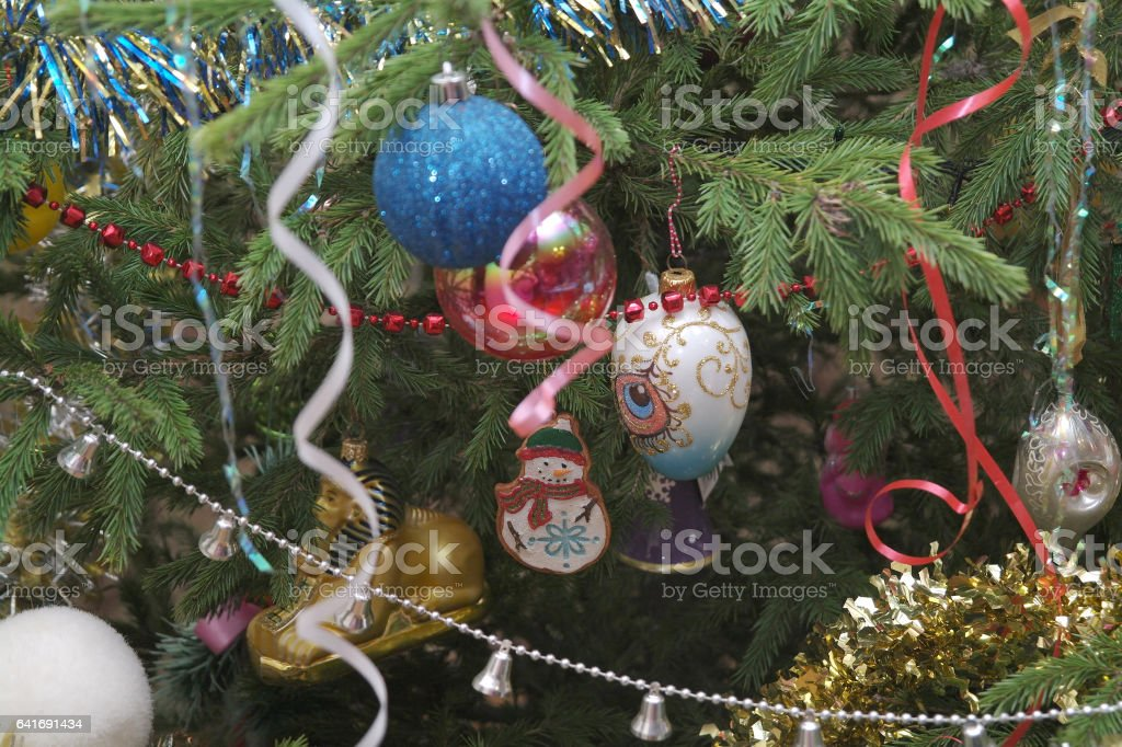 Part of the Christmas tree with ornaments, tree toys shiny and beautiful new year stock photo