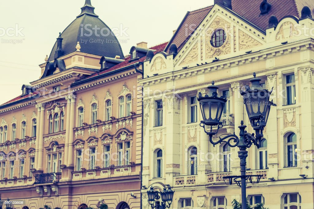 Part of the facade of buildings of Novi Sad, with monuments and statues stock photo
