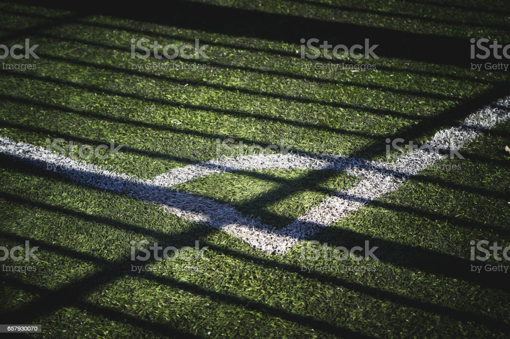 part of the football field with a marking and a shade from the sun stock photo