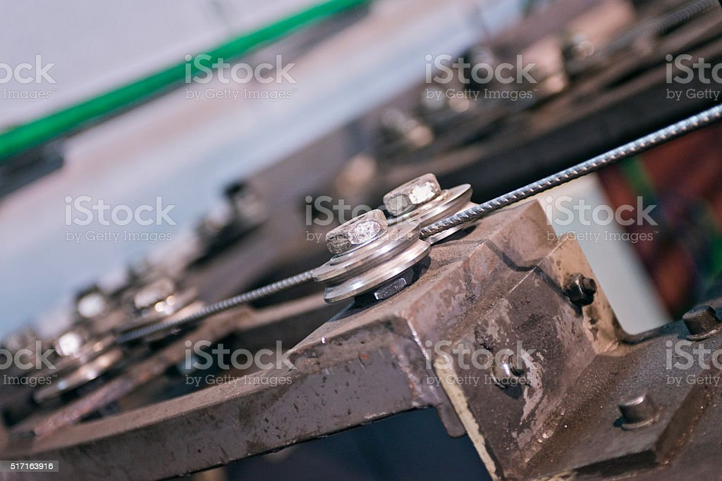 part of the machine for welding wire mesh in action stock photo