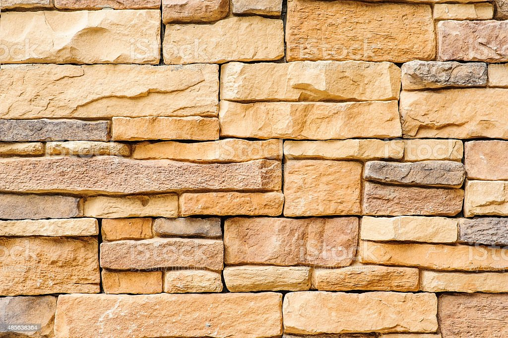 Part of the stone wall. Brown brick wall background texture stock photo