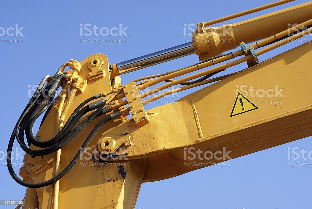 Part of the yellow bulldozer - arm royalty-free stock photo