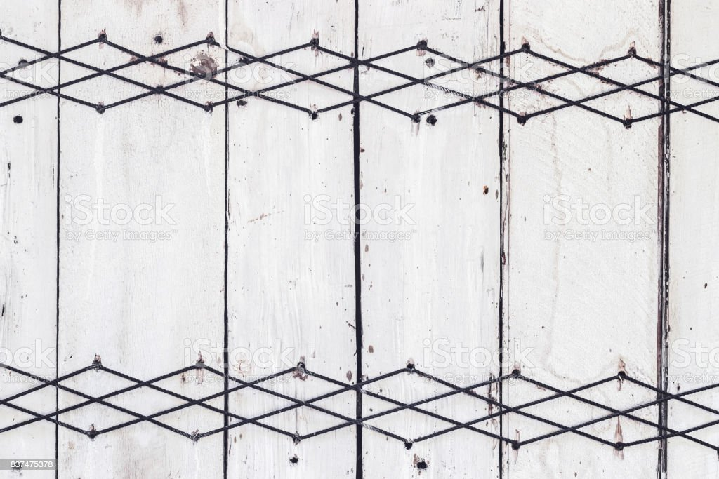Part of traditional russian house wall with with thread patterns and ornaments. Wooden painted texture stock photo