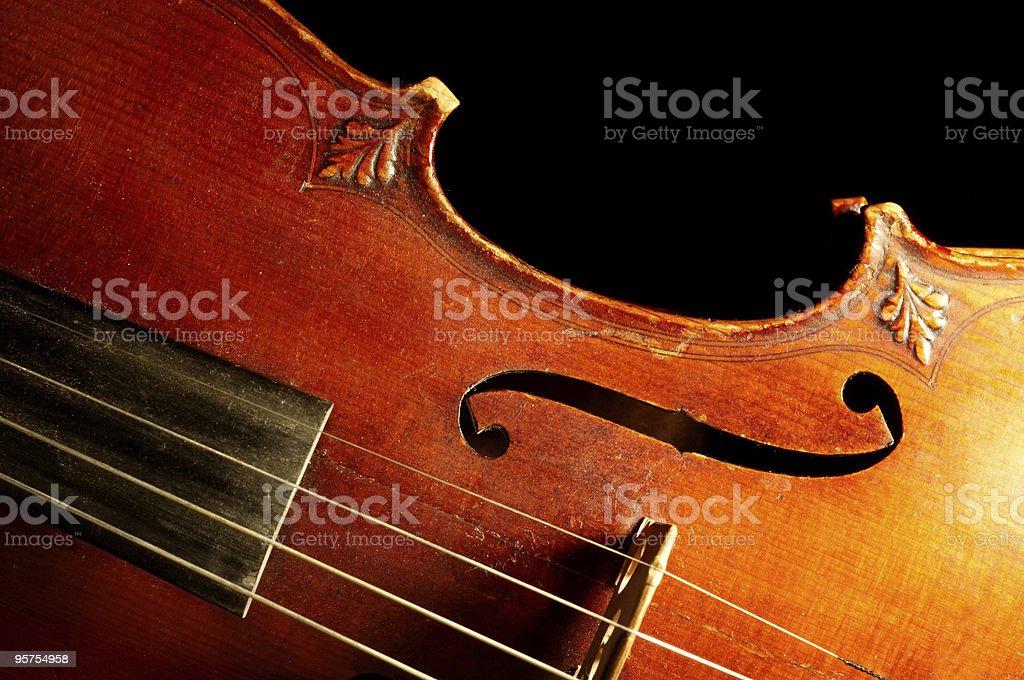 Part of vintage violin on black background stock photo