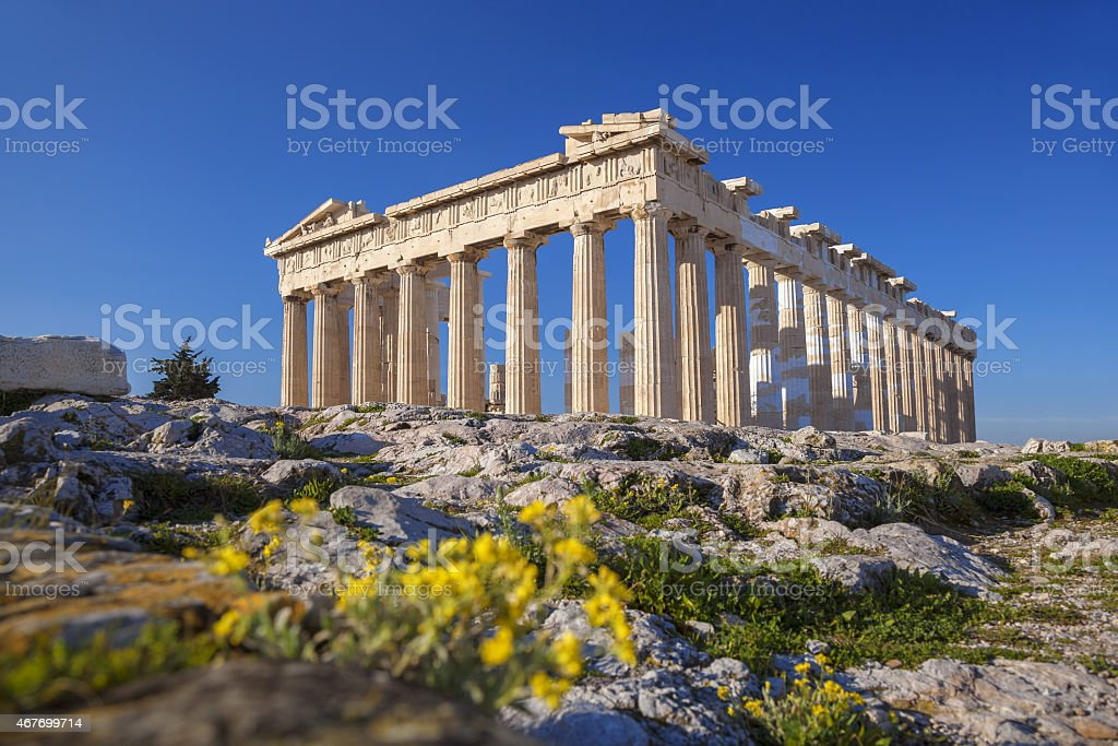 Parthenon temple with flowers on the  Acropolis in Athens, Greece stock photo