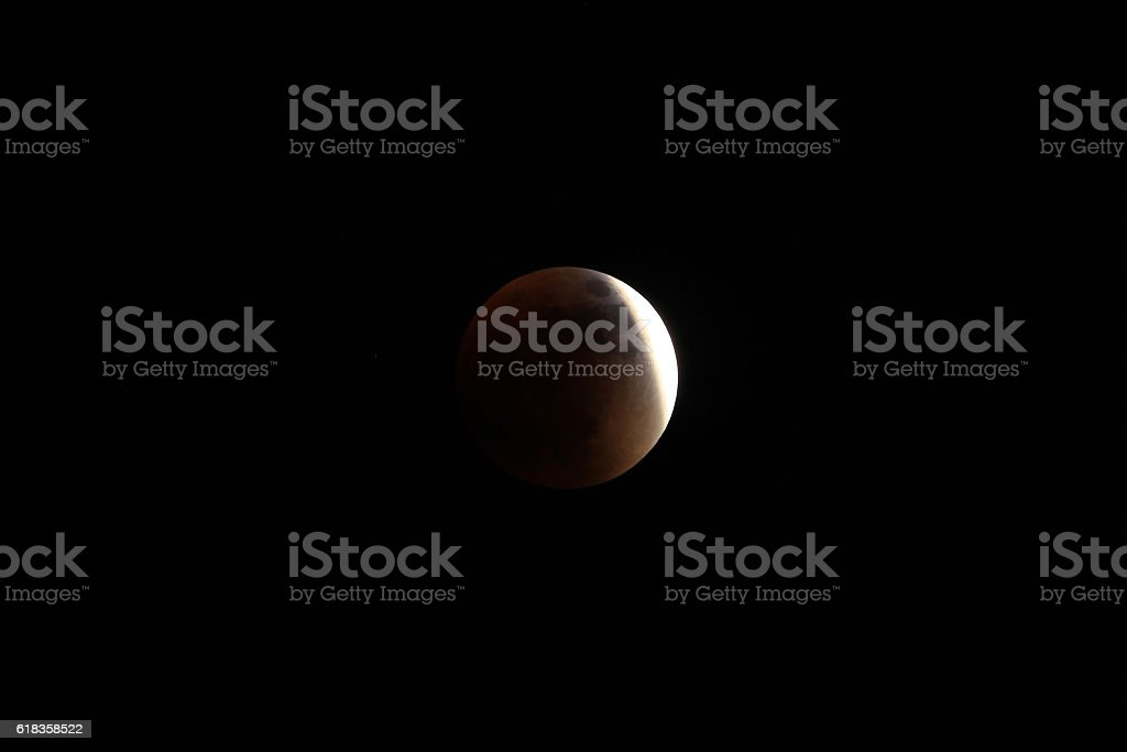 Partial before total lunar eclipse 2015 stock photo