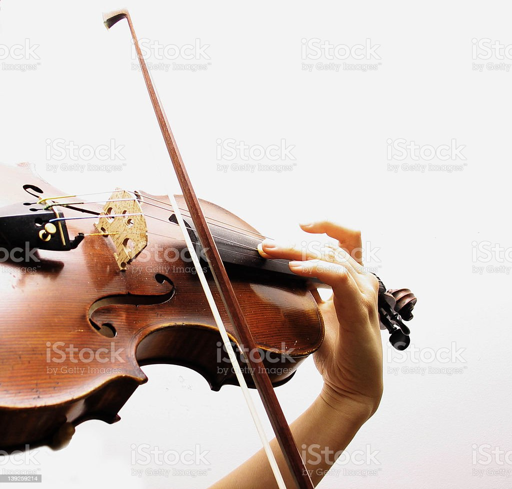 Partial close-up of a violin being played during interlude stock photo