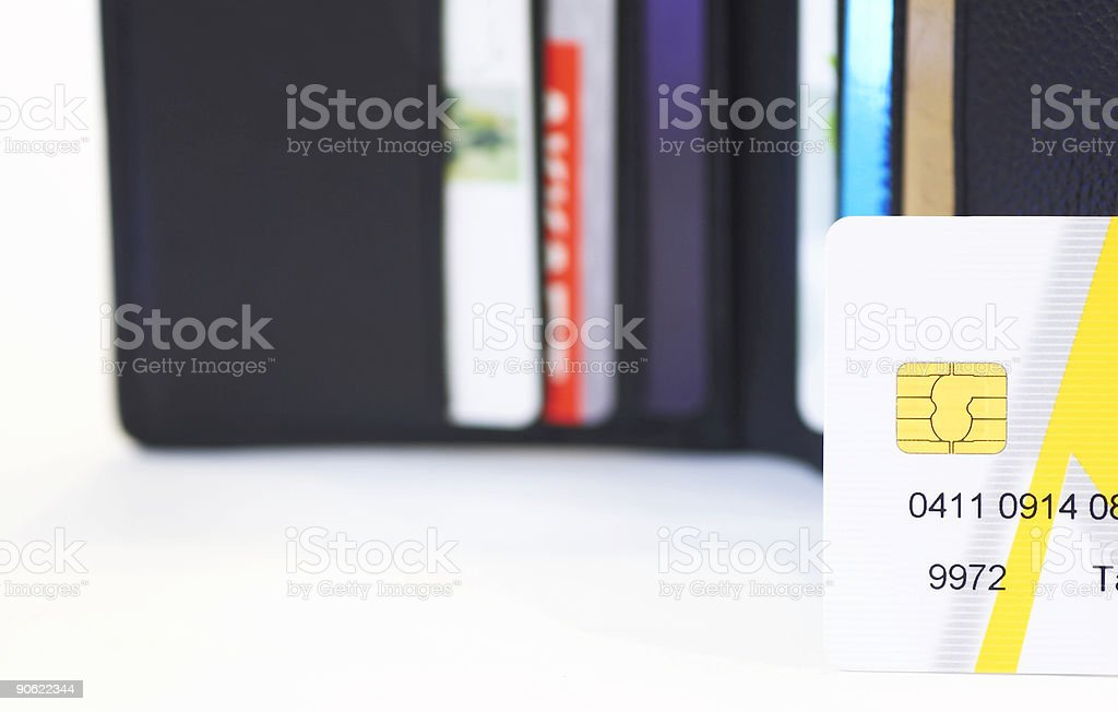 partial credit card in front of wallet stock photo
