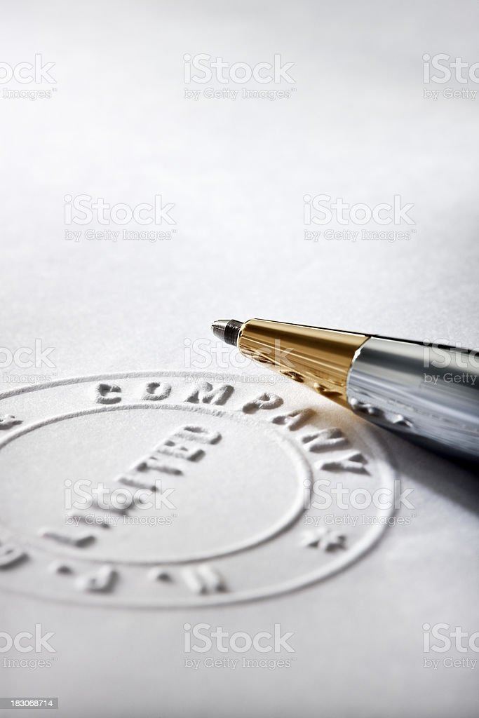 Partial Notary Stamp and Pen stock photo
