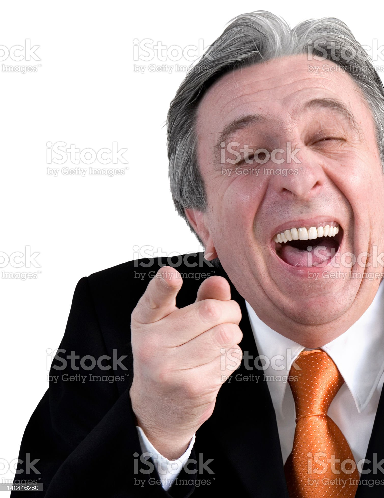 Partial portrait of laughing businessman pointing at camera royalty-free stock photo