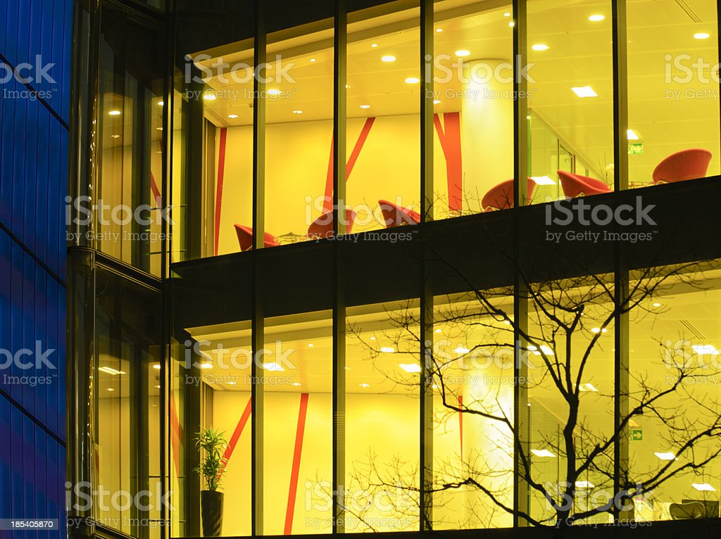 Partial View of  Glass Office Building Illuminated at Night royalty-free stock photo
