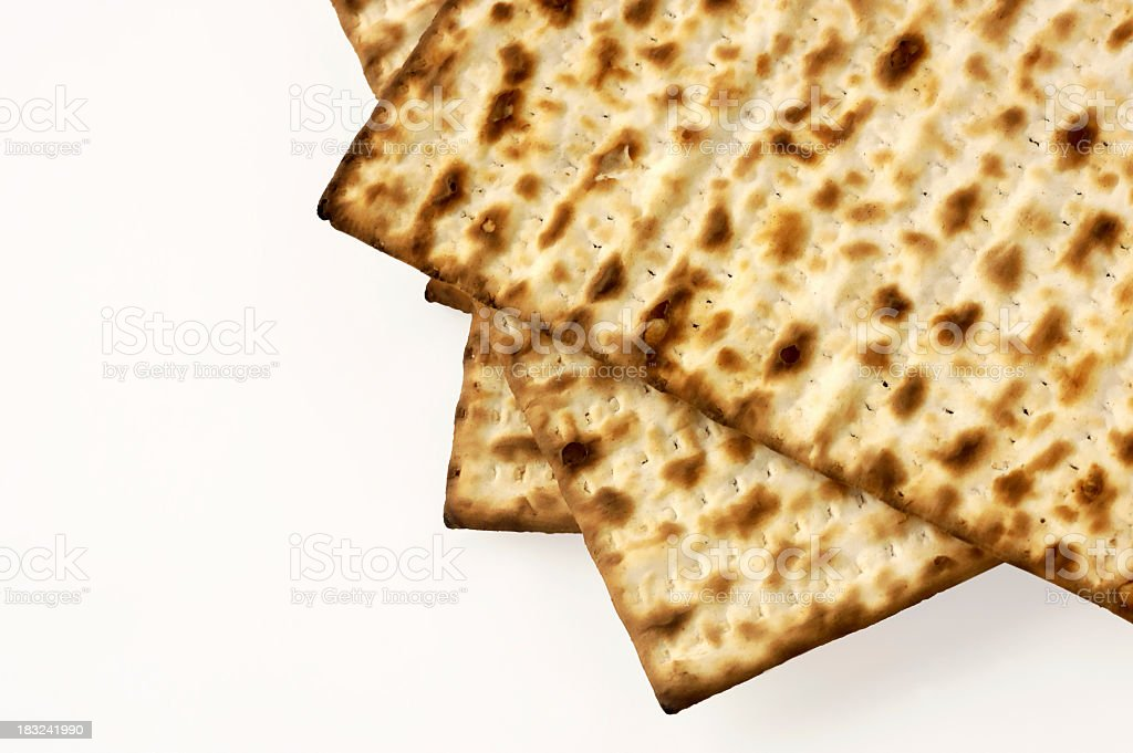 Partial view of Matzoh bread on white background stock photo