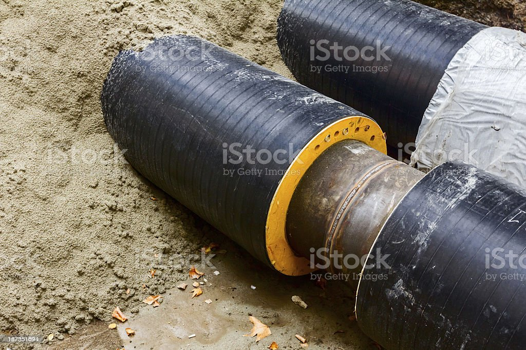 Partially buried pipeline. stock photo