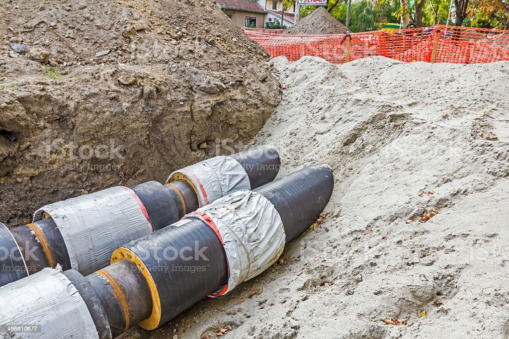 Partially buried pipes stock photo