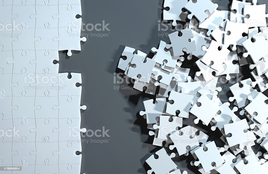 Partially completed puzzle, finding a solution to messy pieces stock photo