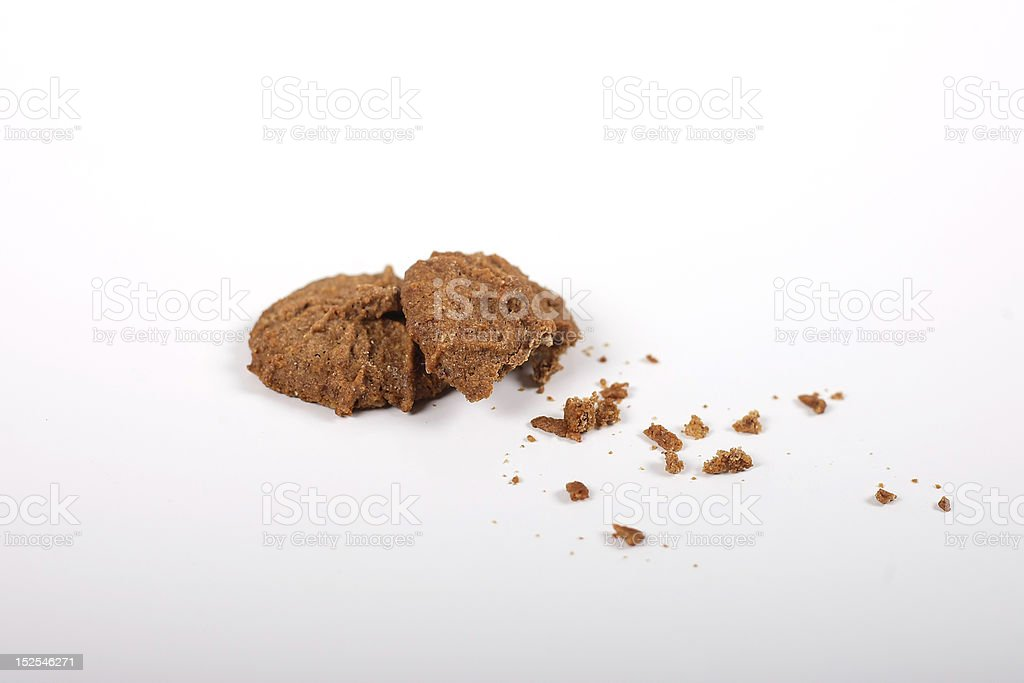 Partially eaten cookies and cookie crumbs royalty-free stock photo