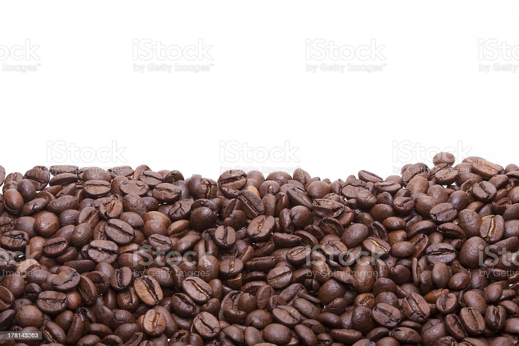 Partially filled with roasted coffee beans background royalty-free stock photo