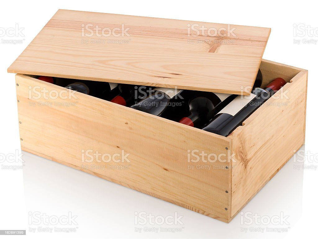 A partially opened wooden box full of red wine  stock photo