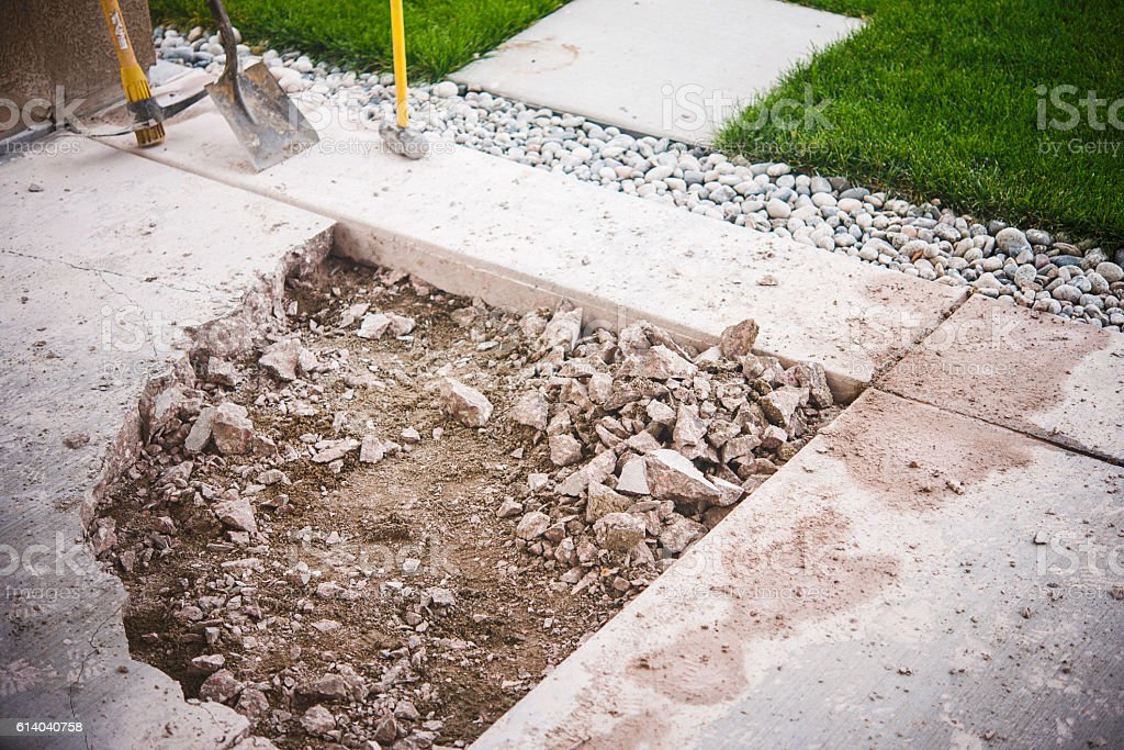Partially removed concrete patio. Home construction and renovation stock photo