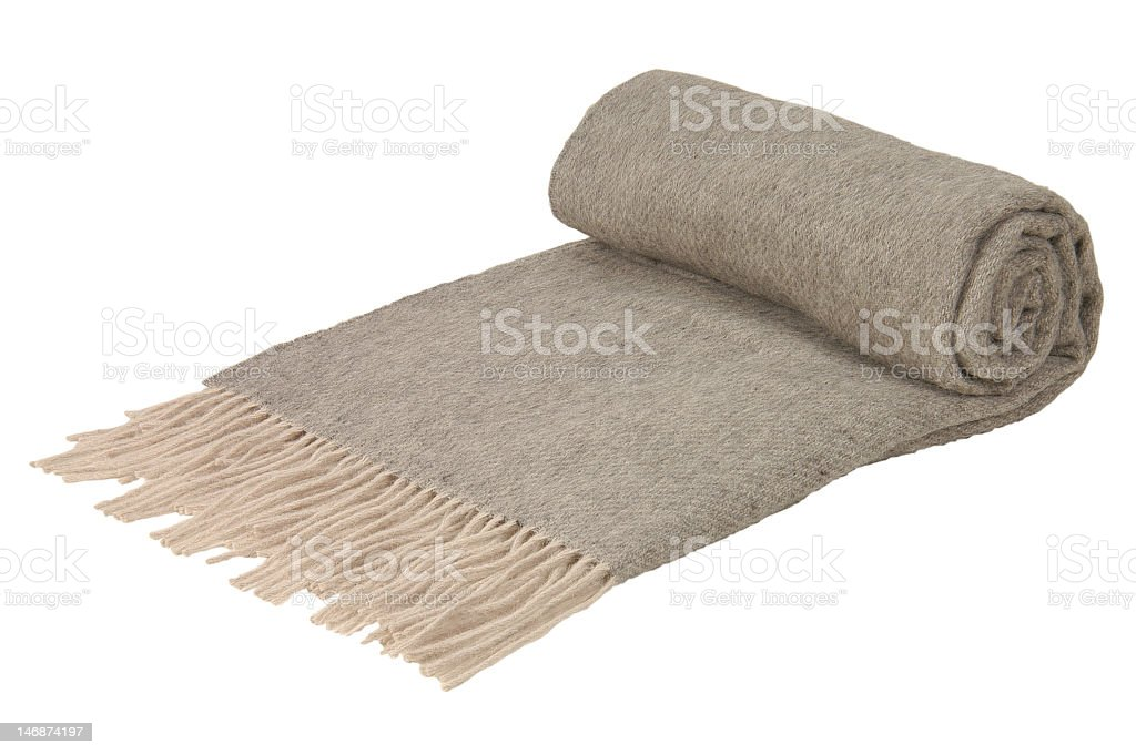 Partially rolled grey blanket with tasseled edge royalty-free stock photo
