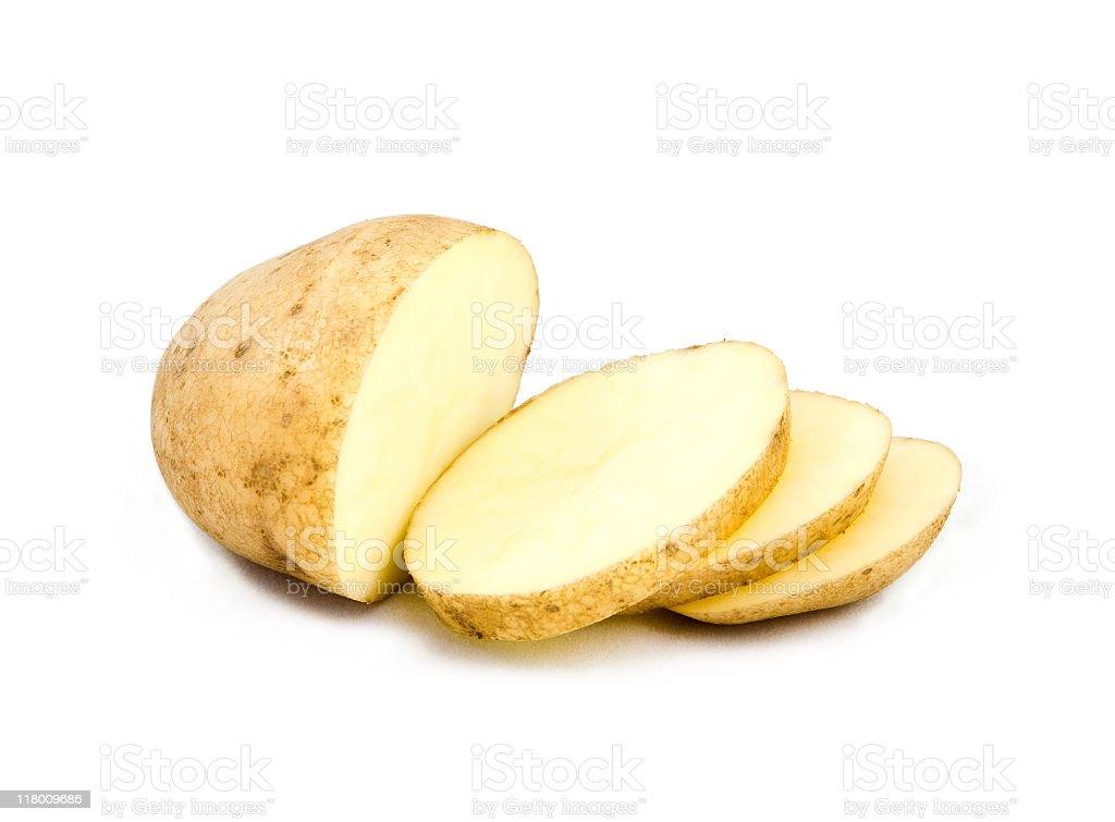A partially sliced potato on white stock photo