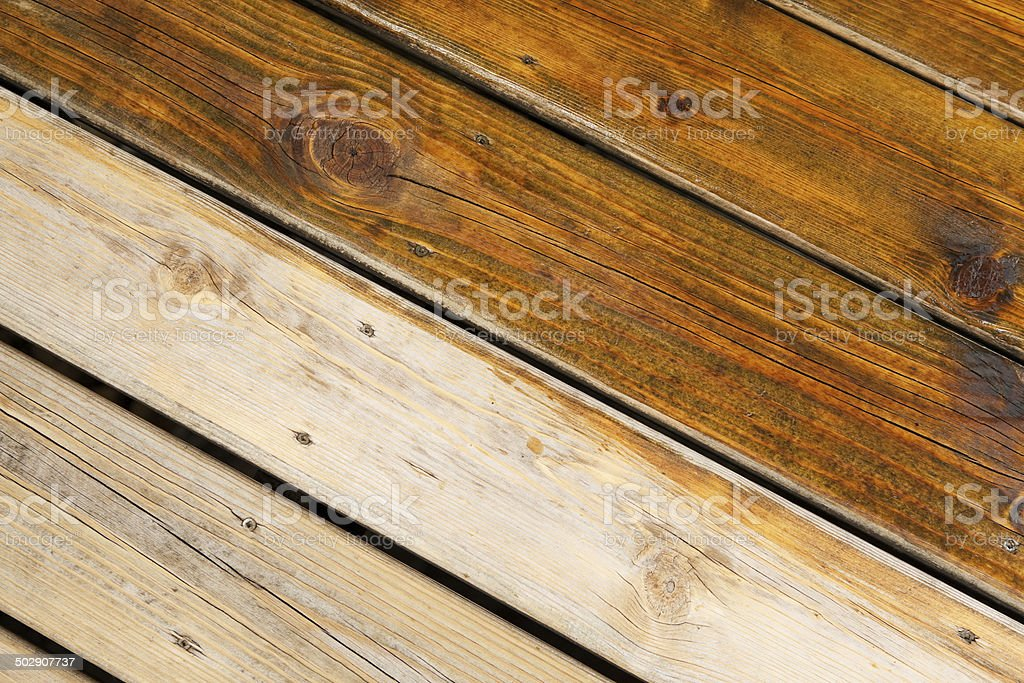 Partially Stained Weathered Deck Boards stock photo