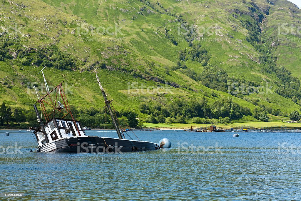 Partially submerged fishing vessel in Loch Linnie royalty-free stock photo