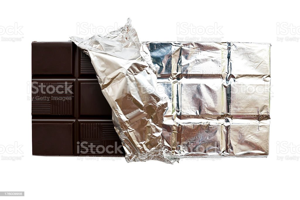 Partially unwrapped chocolate isolated on a white background royalty-free stock photo