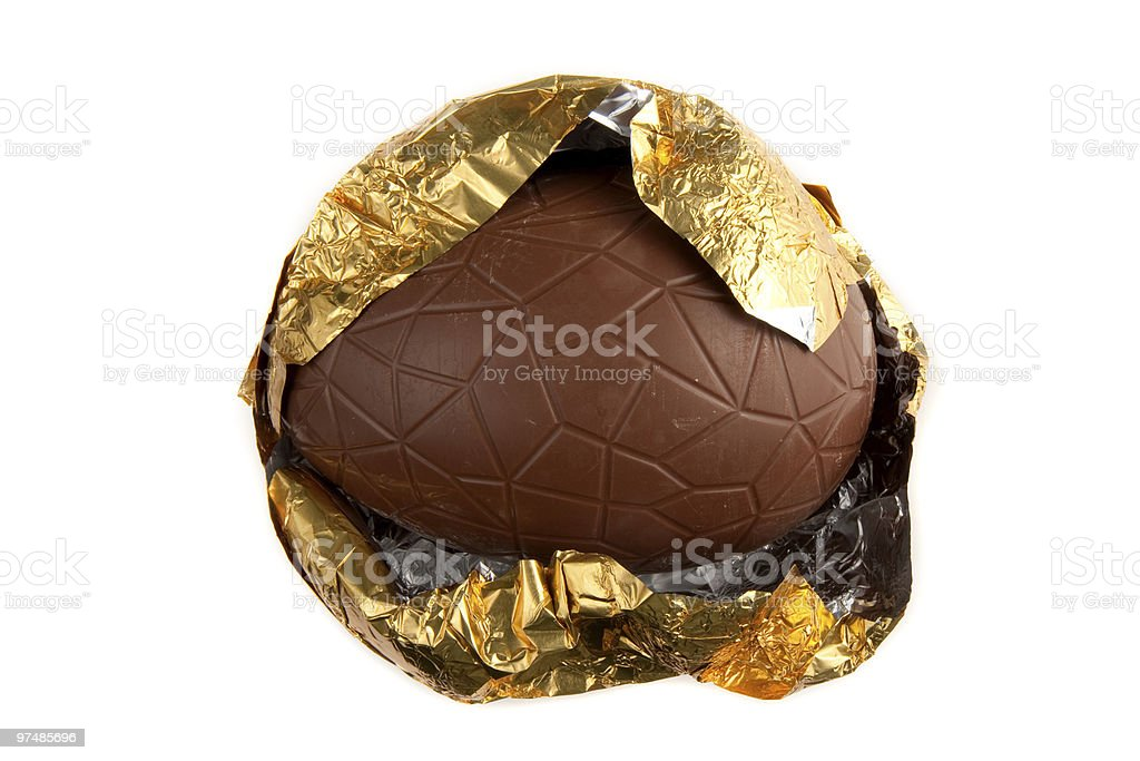 Partially Unwrapped  Easter Egg royalty-free stock photo