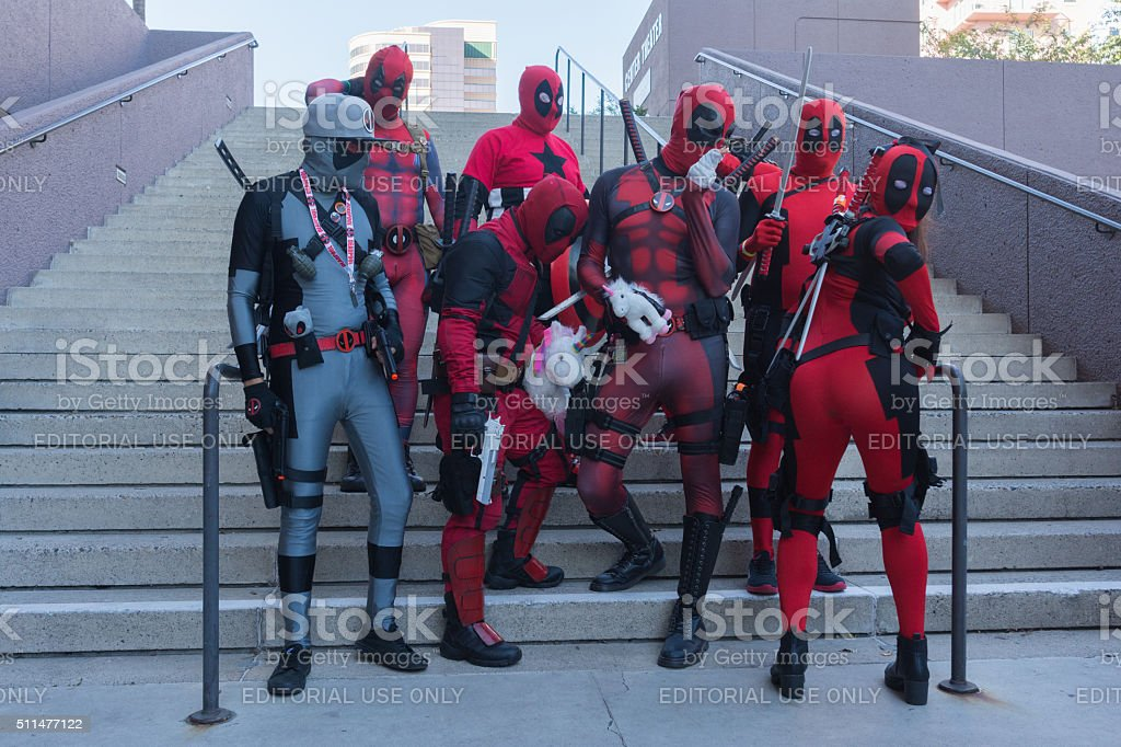Participans with Deadpool costumes stock photo