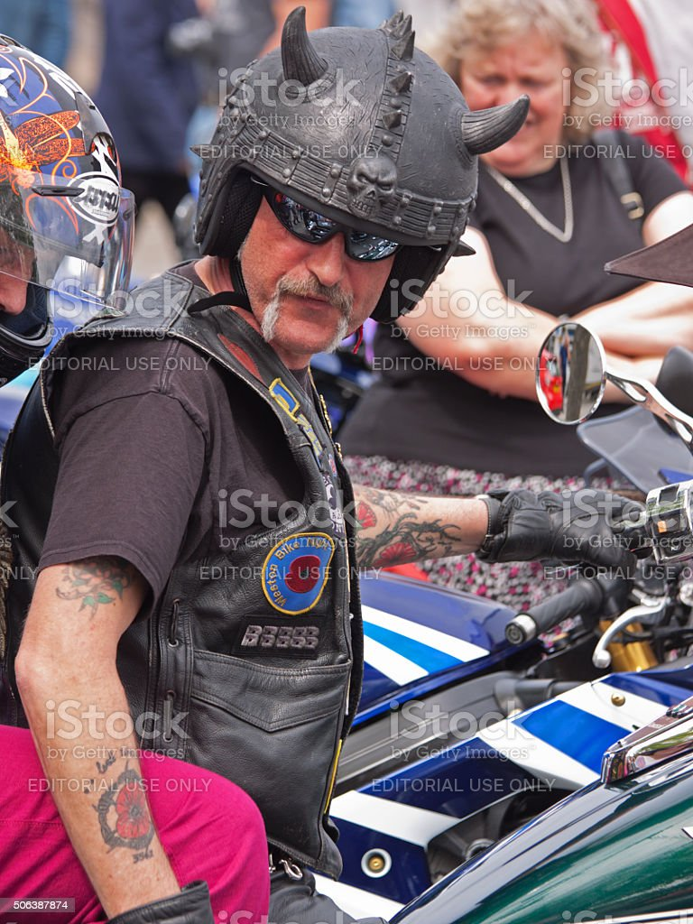Participant at an annual charitable motorcycle show UK stock photo