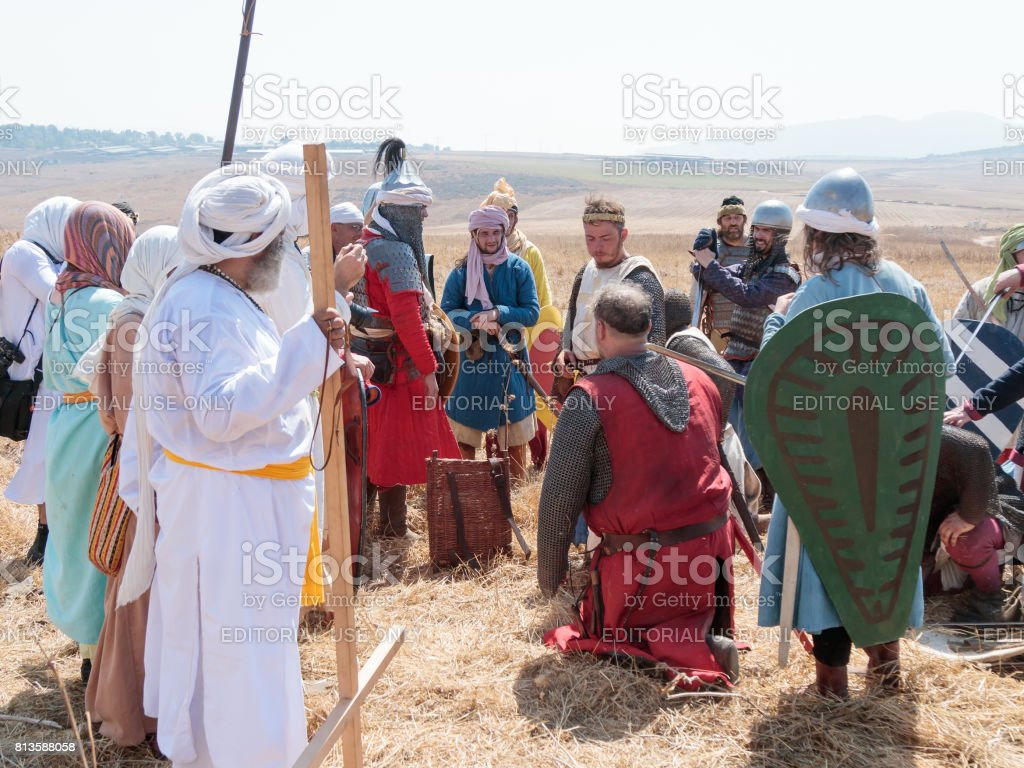 Participant in the reconstruction of Horns of Hattin battle in 1187 acting as Saladin, talking to the prisoners after the battle near Tiberias, Israel stock photo