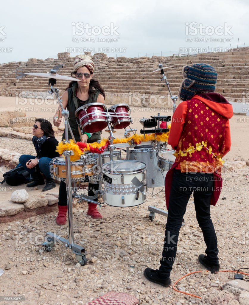 Participant of festival show for viewers show on percussion instruments stock photo