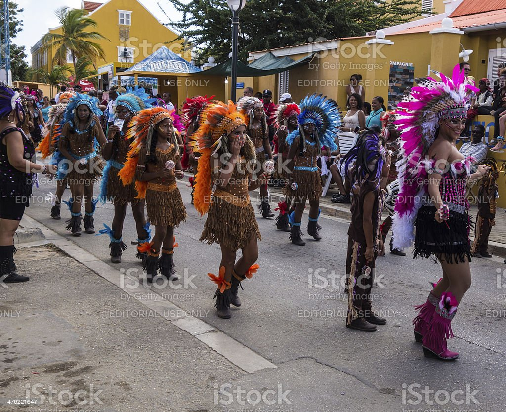Participants Dressed in Native Costume March and Dance  in Carnival Parade stock photo